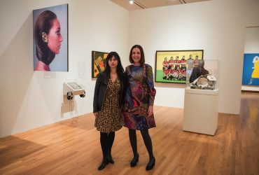 Guest Curator Esther Gabara, E. Blake Byrne Associate Professor of Romance Studies (right), poses in the gallery with Natalia De La Rosa, a postdoctoral associate in the Franklin Humanities Institute at Duke, who assisted with the exhibition Pop América. Photo by J Caldwell.