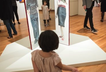 A very young visitor regards herself in Judith F. Baca's work Las Tres Marías. Photo by J Caldwell.