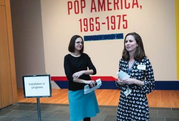 Guest Curator and Duke Professor Esther Gabara and Molly Boarati, Assistant Curator at the Nasher Museum, give a brief introduction at the media preview tour through Pop América. Photo by J Caldwell.