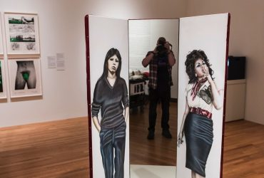 Nasher Museum Photographer J Caldwell takes a selfie with Judith F. Baca's work, Las Tres Marías (The Three Marias), 1976.