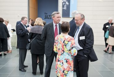 Blake Byrne chats with Ann and Rhodes Craver at an opening event. Photo by J Caldwell.
