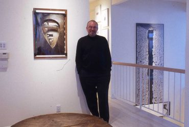 Blake Byrne poses with works of art in his collection at his home in Hollywood Hills, California.