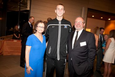 Blake Byrne poses with a Duke Men's Basketball player and Nancy A. Nasher, who is now chair of the museum's Board of Advisors. Photo by J Caldwell.