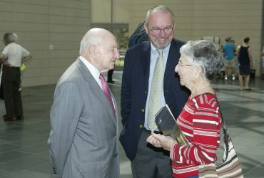 Blake Byrne shakes the hand of museum benefactor and namesake Raymond D. Nasher during the opening of the museum in October 2005. Photo by Duke Photography.