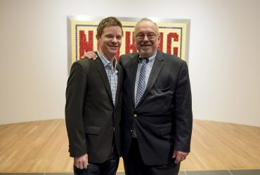 Chief Curator Trevor Schoonmaker poses with Blake Byrne (right) during the opening of the exhibition Open This End. Photo by J Caldwell.