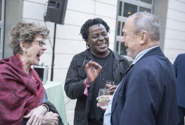 Nasher Museum Director Sarah Schroth laughs with artist John Akomfrah (center) and Blake Byrne. Photo by J Caldwell.