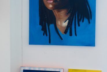 View of several of artist Will Paul Thomas' paintings for the Nasher Teen Council portrait painting workshop in his studio at the Rubenstein Arts Center. Photo by Robert Zimmerman.