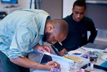 Nasher Teen Council member receives instruction from artist Will Paul Thomas during a portrait painting worksop in the artist's studio at the Rubenstein Arts Center. Photo by Robert Zimmerman.