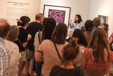 UNC associate Professor Jenny Tone Pah-Hote (Kiowa Tribe of Oklahoma ) leads a gallery tour