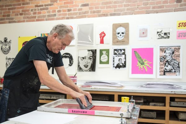 Bill Fick works in his Supergraphic studio in Smith Warehouse, Duke University. Photo by J Caldwell.
