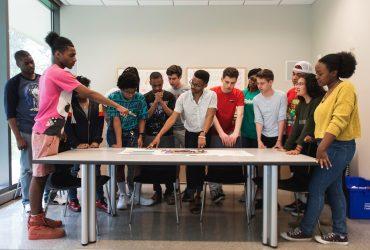 The Nasher Teens meet with Teen Coordinator Jesse Huddleston (center)