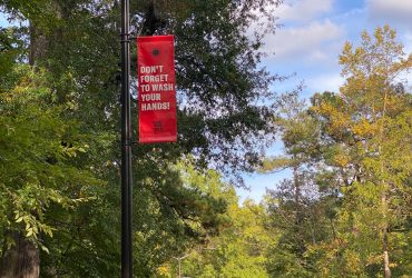 Resist Covid / Take 6! street pole banner lining Campus Drive connecting Duke's east and west campuses. Courtesy of Carrie Mae Weems. Photo by Wendy Hower.