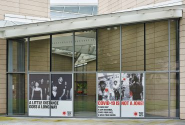 RESIST COVID / TAKE 6! window clings at the Nasher Museum. Courtesy of Carrie Mae Weems. Photo by Robert Zimmerman.
