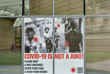 A RESIST COVID / TAKE 6! window cling at the Nasher Museum. Courtesy of Carrie Mae Weems. Photo by Robert Zimmerman.