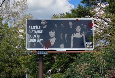 A Resist Covid / Take 6! billboard in Durham, NC. Courtesy of Carrie Mae Weems. Photo by Wendy Hower.