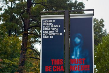 A RESIST COVID / TAKE 6! street pole banner facing Campus Drive at the Nasher Museum. Courtesy of Carrie Mae Weems. Photo by Robert Zimmerman.