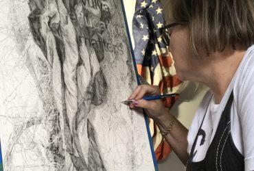 Kiki Farish drawing in her studio.