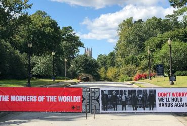 A RESIST COVID / TAKE 6! banner on the iron gates at Duke Gardens. Courtesy of Carrie Mae Weems.
