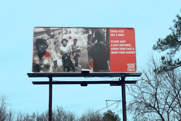 A Resist Covid / Take 6! billboard in Durham along highway 147. Courtesy of Carrie Mae Weems. Photo by J Caldwell.